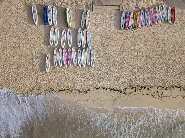 Indonesia, Bali, Aerial view of Pandawa beach, empty canoes — Stock Photo