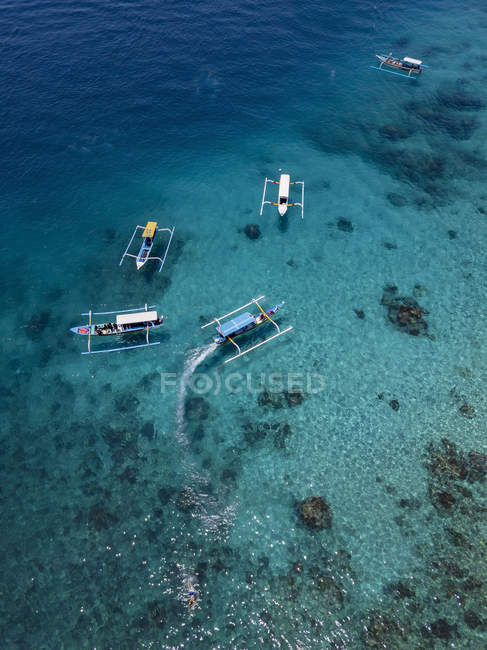 Indonesia, Bali, Aerial view of Blue Lagoon, banca boats — Fotografia de Stock