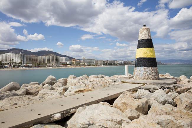 Spain, Andalusia, Torremolinos, Costa del Sol, coast with navigation mark — Stock Photo