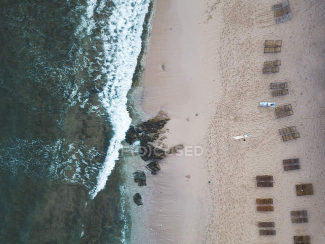 Indonesia, Bali, Aerial view of Balangan beach, empty beach loungers from above — стокове фото