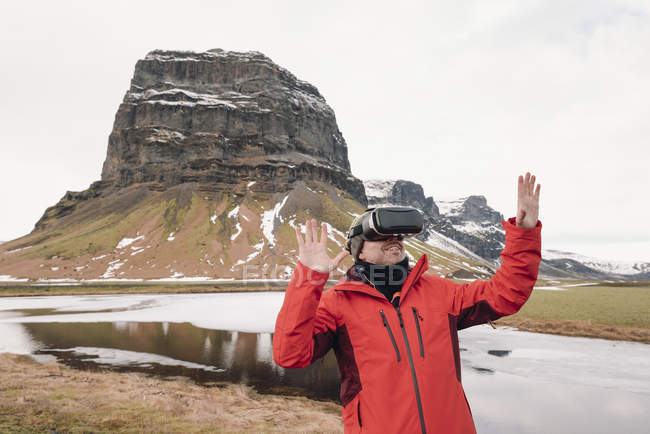 Iceland, man wearing Virtual Reality Glasses in nature — Stock Photo