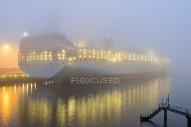 Germany, Hamburg, Harbour, Container ship in the morning — Stock Photo
