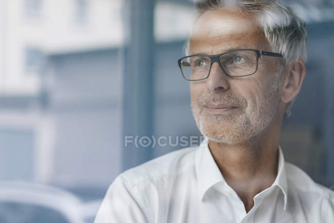 Successful manager looking out of window, thinking, portrait — Foto stock