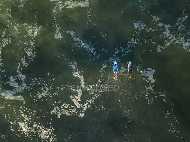 Indonesia, Bali, Kedungu, Surfers in the ocean — Stock Photo