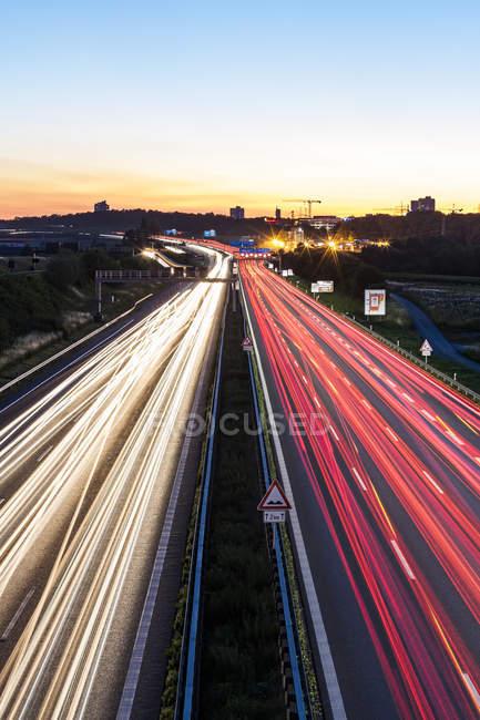 Germany, Baden-Wuerttemberg, Stuttgart, Autobahn A8 in the evening, light trails — Stock Photo