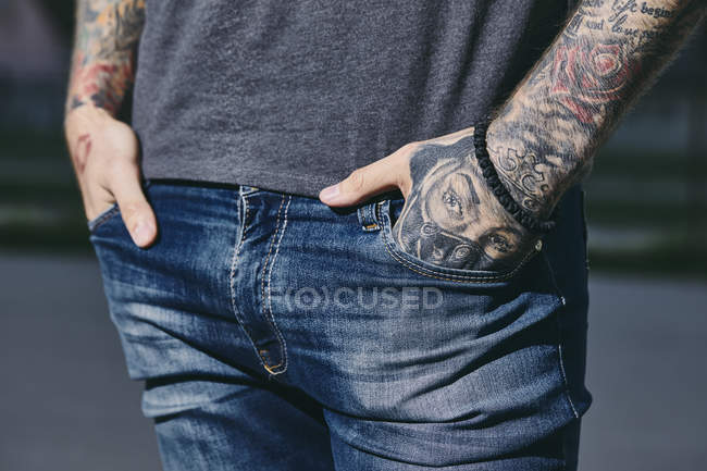 Tattooed arms of a young man outdoors — Stock Photo