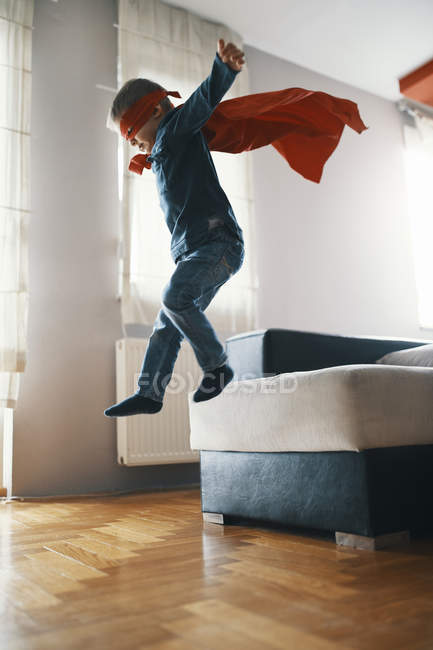 Little boy dressed up as a superhero playing at home — Stock Photo