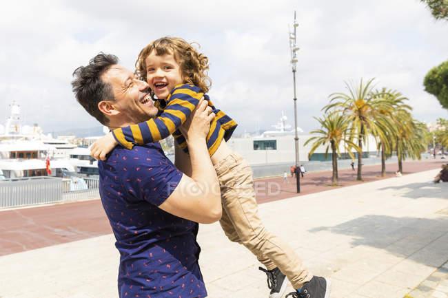 Spain, Barcelona, father and son playing together and having fun — Stock Photo