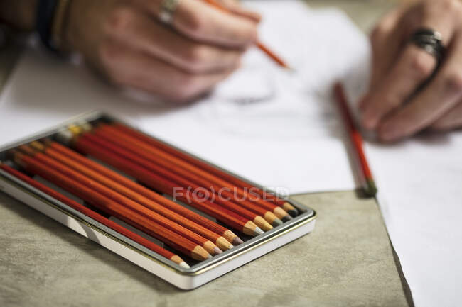 Close-up of artist drawing a sketch — Stock Photo