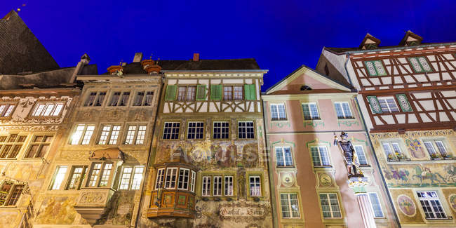 Switzerland, Stein am Rhein, Old town, historical houses at townhall square, fresco paintings, blue hour - foto de stock