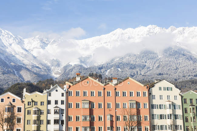 Austria, Innsbruck, row of houses in front of Nordkette Mountains — Stock Photo