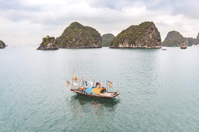 Vietnam, Ha Long bay, with limestone islands and small boat — Stock Photo