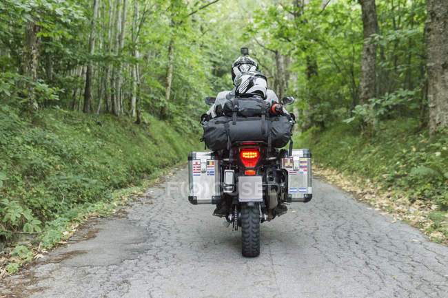 Father and son on a motorbike trip on a country road — Stock Photo