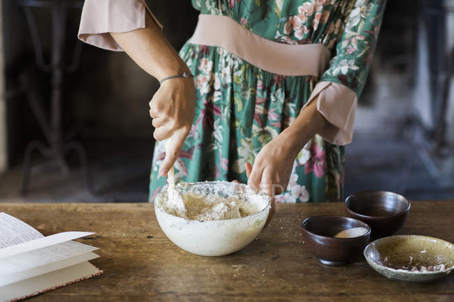 Young woman preparing cake dough, partial view — Stock Photo