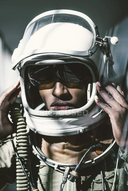 Portrait of serious astronaut in spacesuit — Stock Photo