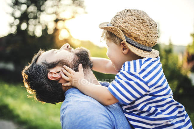 Little boy having fun with his father outdoors — Stock Photo
