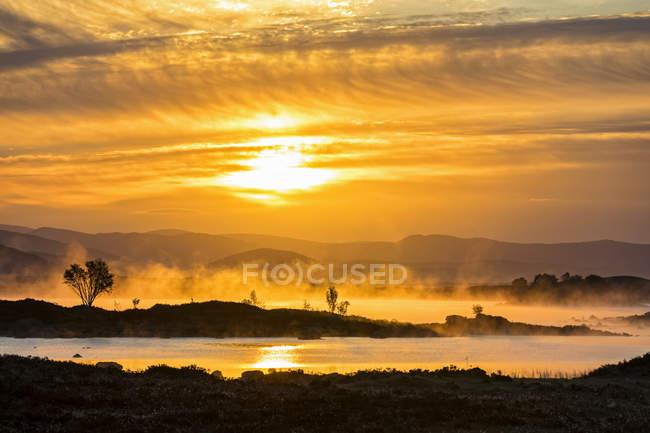 Великобританія, Шотландія, шотландський нагір'я, glencoe, Rannoch Мур, Схід сонця над Лох-ба — стокове фото