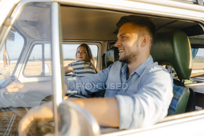 Young couple on a trip in camper van — Stock Photo