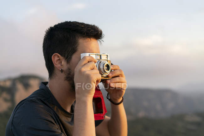 Spain, Barcelona, Natural Park of Sant Llorenc, man taking a picture of the view — Stock Photo