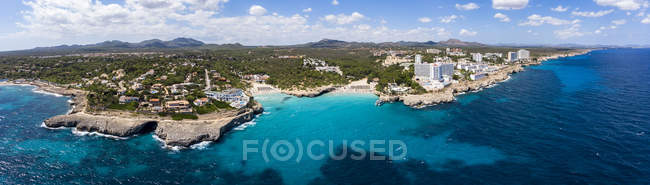 Spain, Baleares, Mallorca, Porto Colom, Aerial view of Cala Tropicana and Cala Domingo — Stock Photo