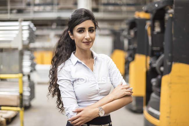 Portrait of confident woman in factory shop floor — Stock Photo