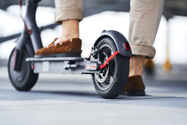 Man standing on E-Scooter, partial view — Stock Photo