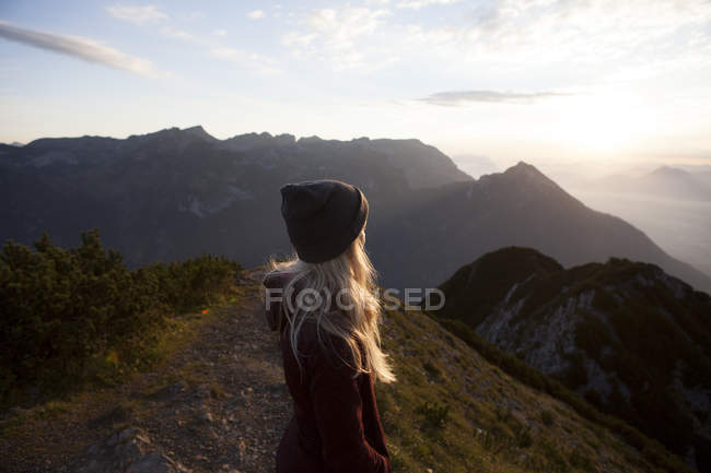 Austria, Tyrol, hiker enjoying the view on Achensee at sunrise — Stock Photo