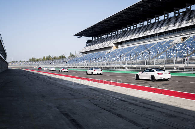 Cars in a row on racetrack — Stock Photo