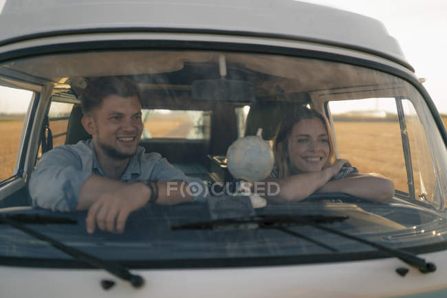 Happy young couple on a trip in camper van — Stock Photo