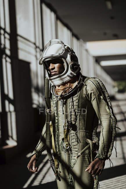 Standing astronaut in spacesuit — Stock Photo