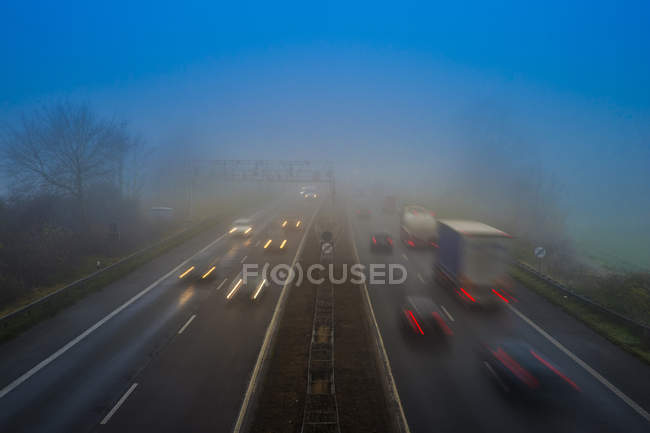 Motorway A 46, traffic in the morning mist — Stock Photo