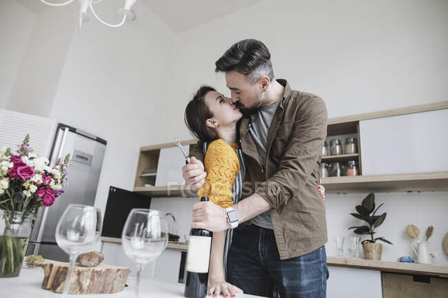 Couple in love kissing in the kitchen — Stock Photo