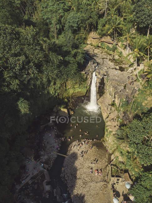 Indonesia, Bali, waterfall and people — стокове фото