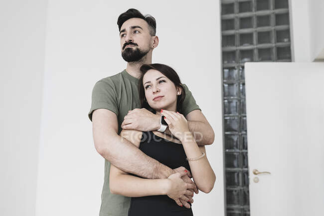 Sensual couple embracing at home — Stock Photo