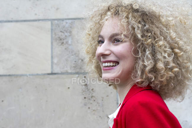 Portrait of laughing blond woman with ringlets — Stock Photo