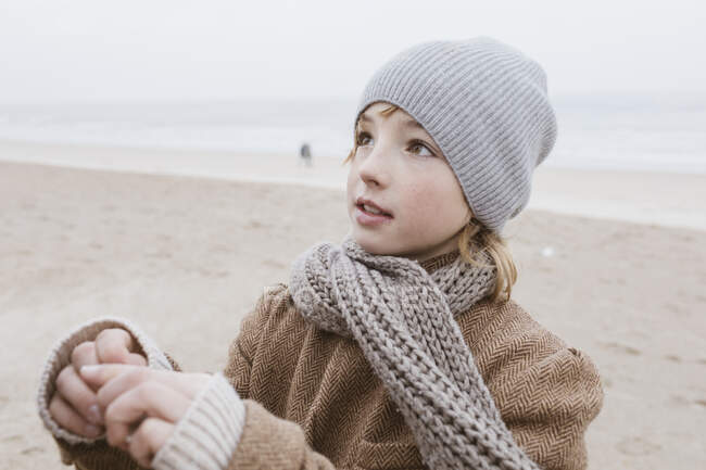 Portrait of boy on the beach in winter — Stock Photo