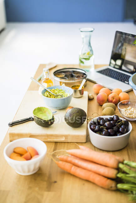 Healthy fruits and vegetables on a kitchen surface — Stock Photo