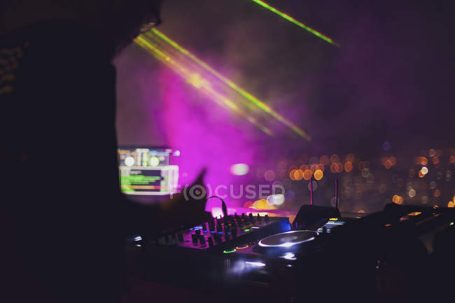 Vietnam, Ho Chi Minh City at night, DJ in the foreground — Stock Photo