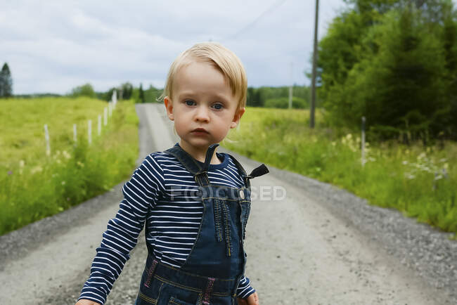 Portrait of serious little girl outdoors — Stock Photo