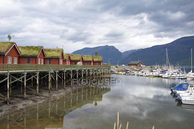 Norway, Manndalen wooden huts and harbor — Stock Photo