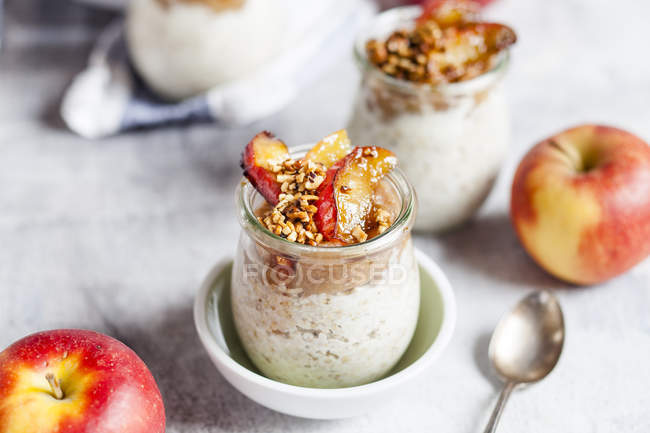 Apple pie overnight oats with caramelized apples and hazelnuts — Stock Photo