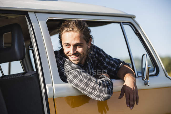 Young man on a road trip with his camper — Stock Photo