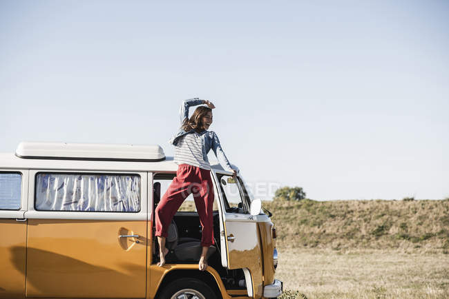 Pretty woman on a road trip with her camper, cheering, enjoying freedom — Stock Photo