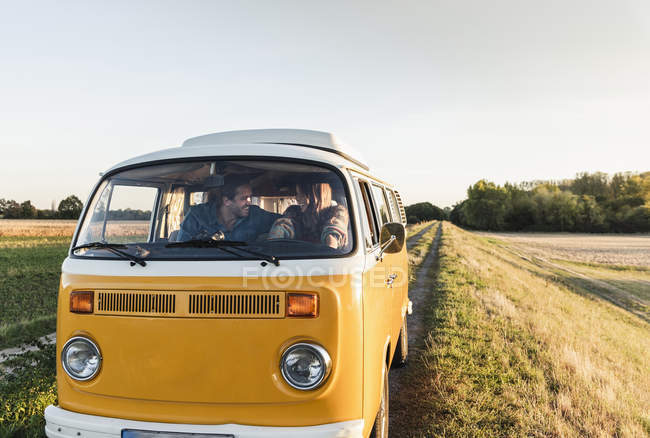 Young couple doing a road trip in their camper — Stock Photo