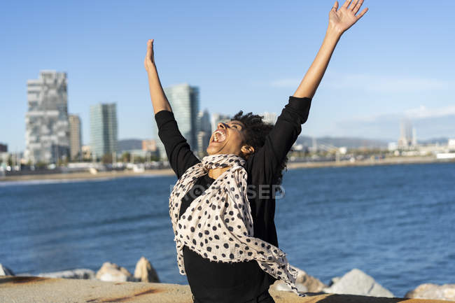 Spain, Barcelona, happy woman shouting of joy in front of the sea — Stock Photo