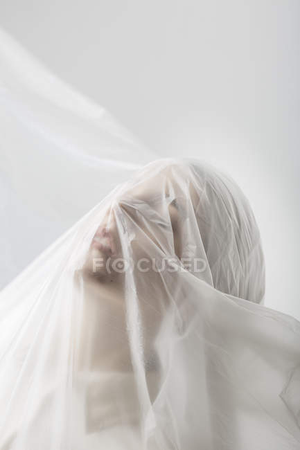 Graceful woman trapped in a veil — Stock Photo