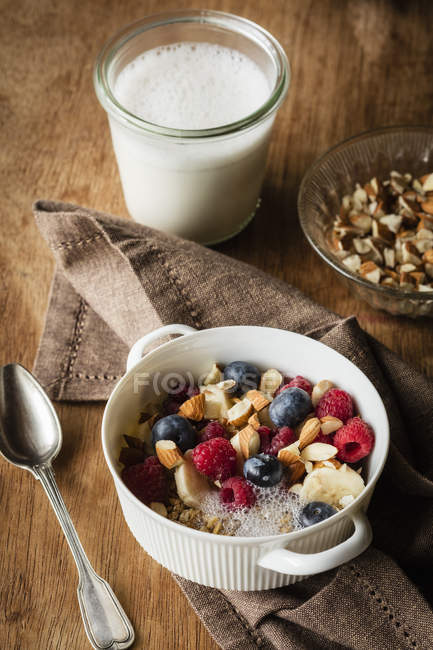 Cereals with almond milk, nuts and berries, vegan — Stock Photo