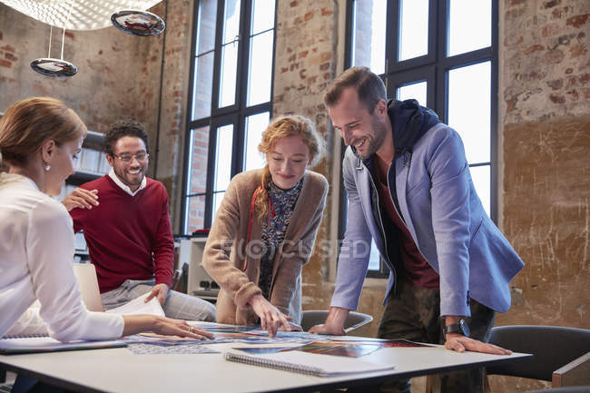 Colleagues brainstorming at a meeting in creative office — Stock Photo