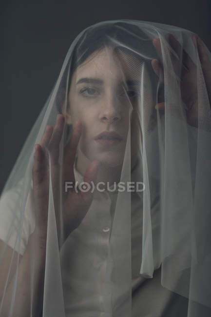 Melancholic woman under a veil — Stock Photo