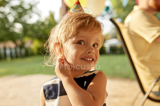 Portrait of little girl on a birthday garden party — Stock Photo